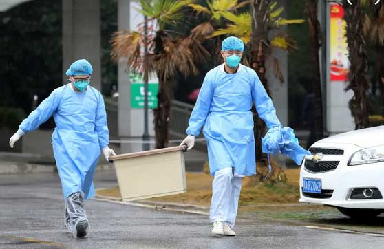 Medical workers near the Jinyintan hospital in Wuhan, China, which housed patients with the coronavirus, on January 10. Reuters