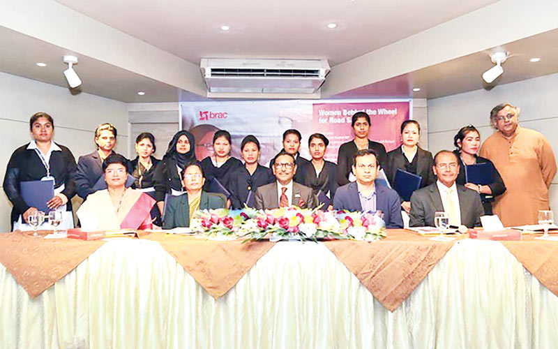 Road, Transport and Bridges Minister Obaidul Quader, along with driving training participants, poses for a photo at a certificate giving ceremony of BRAC Driving Training School at BRAC Centre in the capital�s Mohakhali on Saturday. photo: bdnews24.com