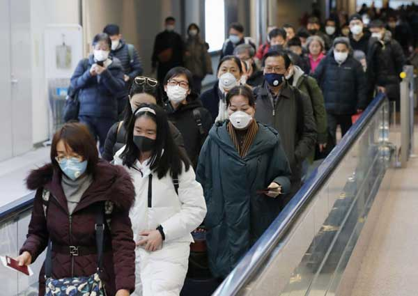 Japan warns about risks to economy from China virus outbreak