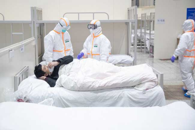 Anger and virus cases grow in China with 722 total deaths