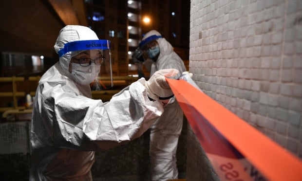 Police cordon off a residential estate in Hong Kong. The global death toll from coronavirus could be massive, says Gabriel Leung. Photo: Getty Images