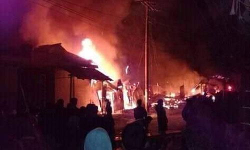 Fire burns down 14 shops
