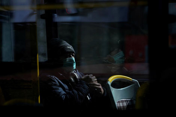 A man wearing a mask is seen on a bus, in downtown Shanghai, China, as the country is hit by an outbreak of a new coronavirus, February 12, 2020. Photo: Reuters