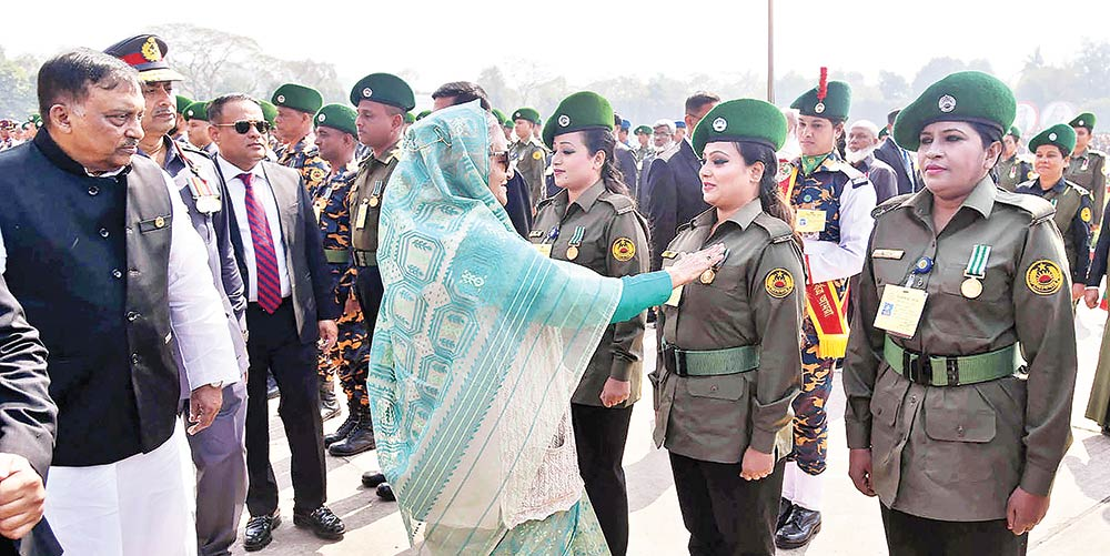 Prime Minister Sheikh Hasina adorning one of the Ansar and VDP members with special medal at the 40th national rally of Bangladesh Ansar and Village Defence Party (VDP) at the Bangladesh Ansar-VDP Academy at Shafipur in Gazipur on Thursday.photo : pid