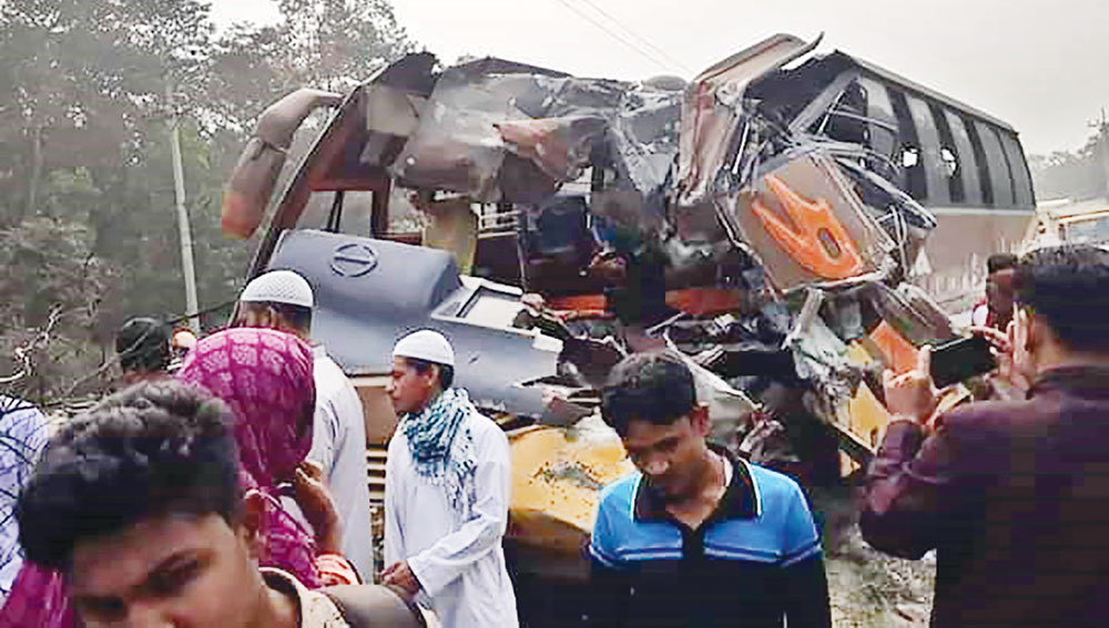 Onlookers gather after a road crash wrecked the front end of a bus while the van rolled over, leaving two passengers dead and 27 others injured at Rajendrapur in Gazipur on Saturday. At least four people were killed and 30 others injured in separate road accidents in the district on the day.PHOTO: OBSERVER