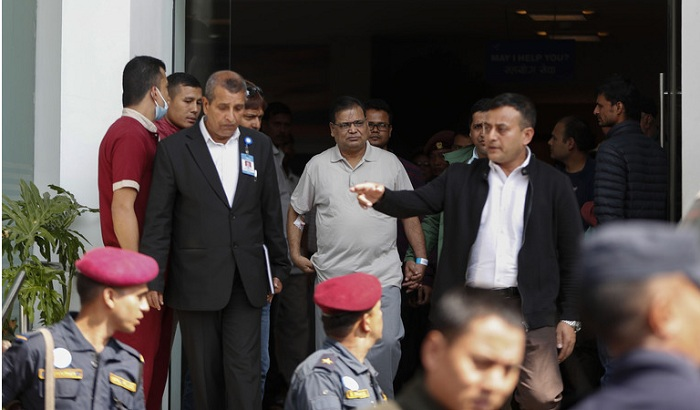FILE- In this Oct. 15, 2019 file photo, former speaker of Nepal's parliament, Krishna Bahadur Mahara, center, leaves a hospital to appear before a... (AP Photo/Niranjan Shrestha, File) More