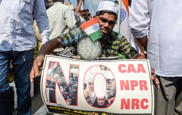 A demonstrator holds a placard during a protest organised by various Muslim organisations and opposition parties against India's new citizenship law, in Chennai on February 19, 2020. Photo : AFP