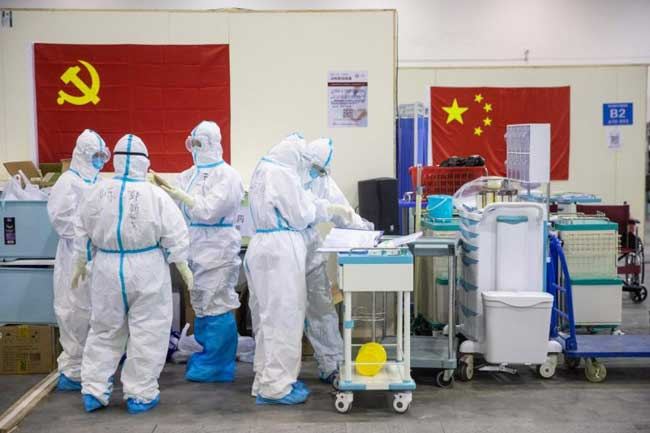 China sees drop in new virus cases