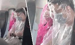 Passengers wrap themselves in plastic