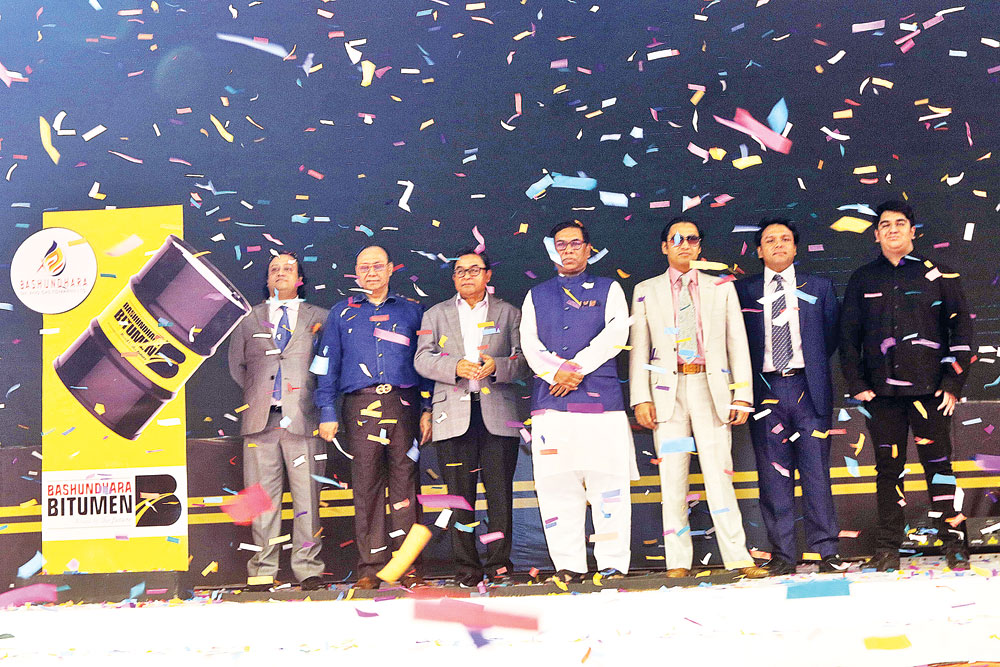 Finance Minister AHM Mustafa Kamal inaugurating country's first-ever 'Bashundhara Bitumen Plant' at Pangaon in Keraniganj on Saturday. State Minister for Power, Energy and Mineral Resources Nasrul Hamid, Bashundhara Group Chairman Ahmed Akbar Sobhan, among others, were present at the programme.PHOTO: OBSERVER