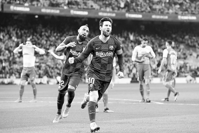 Barcelona's Argentine forward Lionel Messi (R) celebrates after scoring during the Spanish league football match FC Barcelona against SD Eibar at the Camp Nou stadium in Barcelona on February 22, 2020.photo: AFP