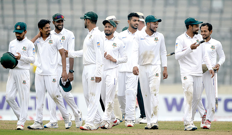 Bangladeshi cricketers walk off the field after winning the test match between Bangladesh and Zimbabwe during the fourth day at the Sher-e-Bangla National Cricket Stadium in Dhaka on February 25, 2020. 	photo: AFP