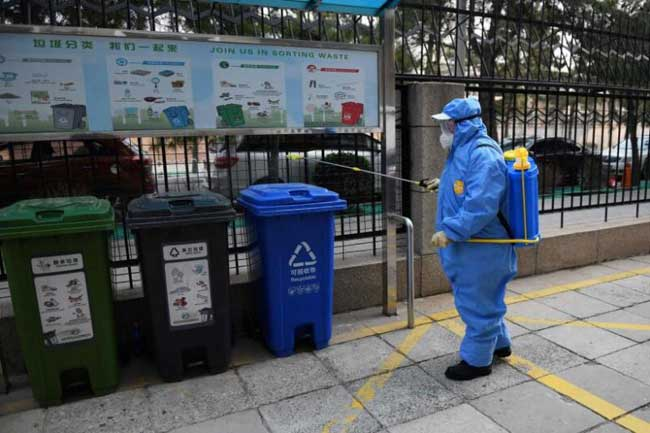 China reports 27 new virus deaths, lowest rise in cases since Jan