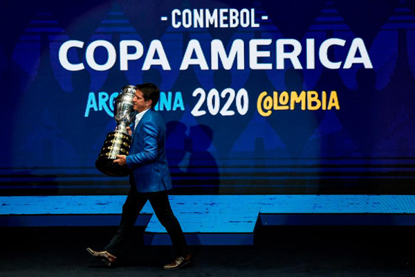 Brazilian former footballer Juninho Paulista presents the Copa America trophy on the stage. Photo: Getty Images