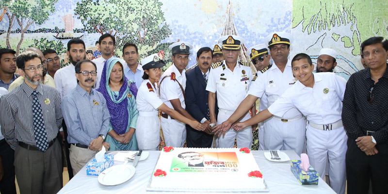 Captain Masuq Hassan Ahmed, Principal of Marine Fisheries Academy, Chittagong, cutting a cake along with trainers, officials, employees and cadets of the Academy on its campus on Tuesday in celebration of Father of the Nation Bangabandhu Sheikh Mujibur Rahman's birth centenary.