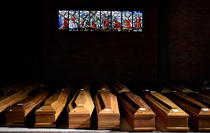Coffins of people who have died from coronavirus are seen in the church of the Serravalle Scrivia cemetery, Italy on March 23. Photo: Reuters