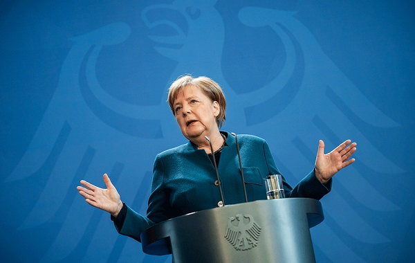German Chancellor Angela Merkel makes a press statement on the spread of the coronavirus at the Chancellery, in Berlin on March 22. Photo: AFP