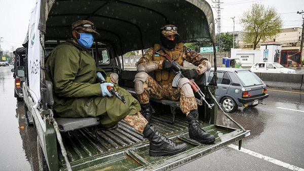 Pakistan troops patrol wearing facemasks as a government-imposed lockdown against the coronavirus takes hold in Rawalpindi --AFP