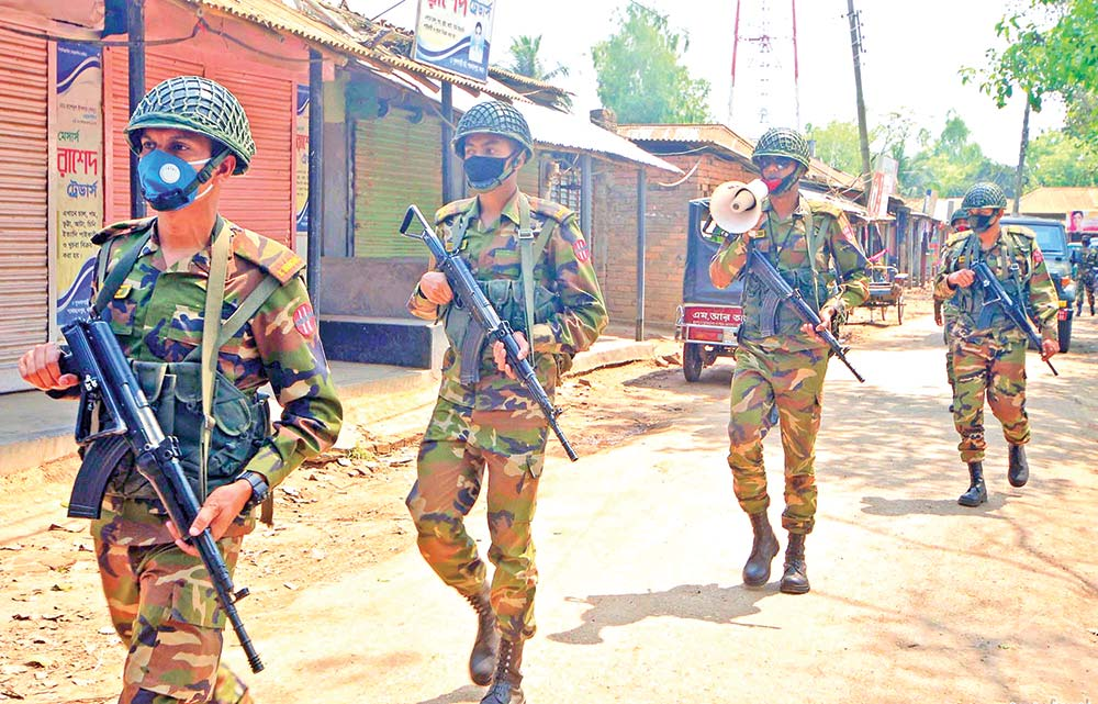 Members of Bangladesh Army start fieldwork to help the civil administration contain the spread of coronavirus. The photo was taken from Bogura on Wednesday.photo : Observer
