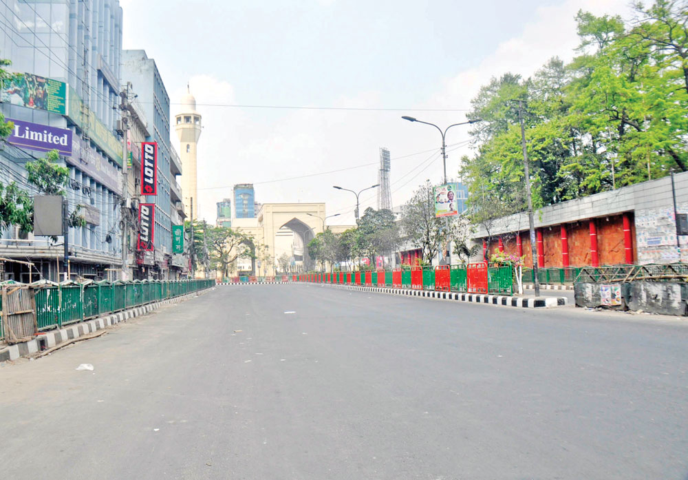 A rare view of the Bangabandhu Avenue with no living thing in sight in the afternoon on Thursday amid a countrywide lockdown to prevent the  spread of deadly coronavirus.   	PHOTO: OBSERVER