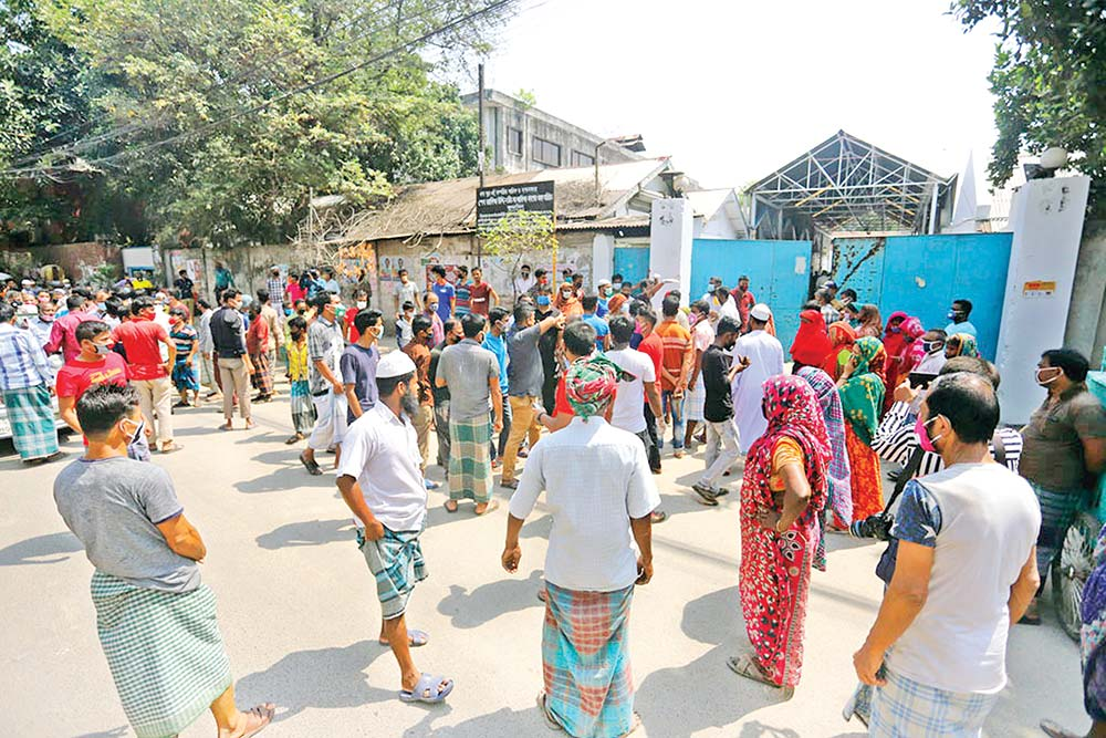 Locals of the Tejgaon Industrial Area in the capital on Saturday protested against the construction of a hospital for the coronavirus patients by the Akij Group of Industries. photo : Observer