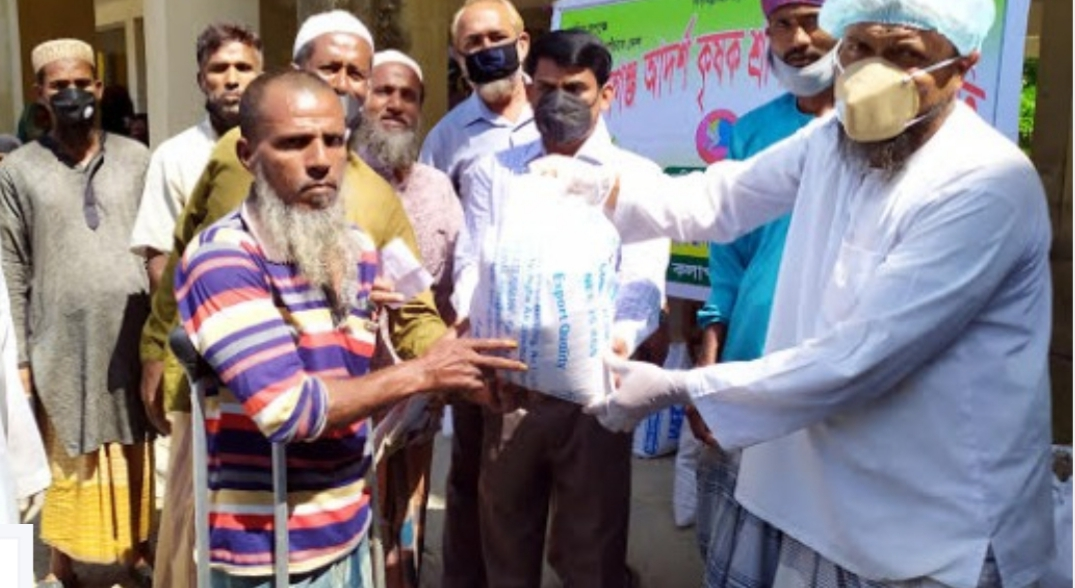 Framers stand beside fellows, give relief materials