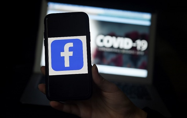 Facebook logo is displayed on a mobile phone screen photographed on coronavirus Covid-19 illustration graphic background on March 25, 2020 in Arlington. File photo: AFP