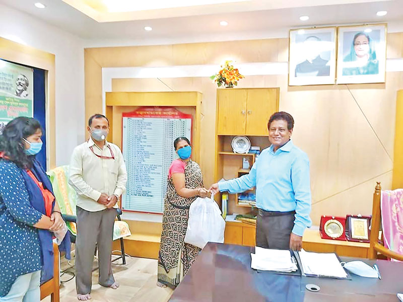 'Sohay', a local of organisation of Feni, distributed food items among the outsourcing staff of 250-Bed