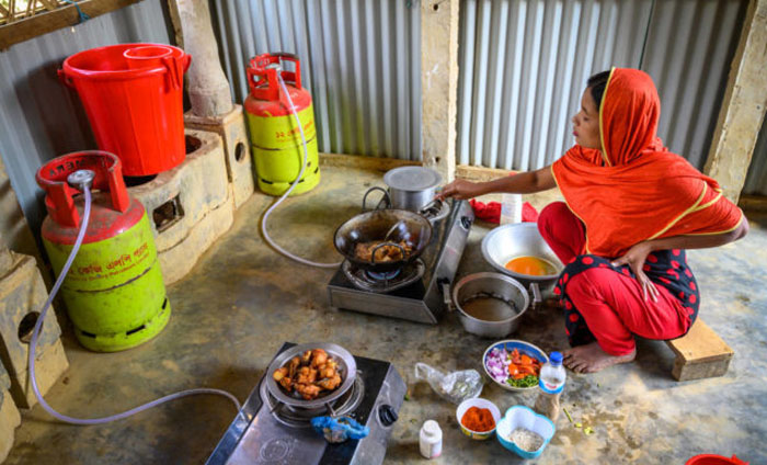 A woman cooking food using LP gas in a remote village of Bangladesh. PHOTO: DAILY OBSERVER