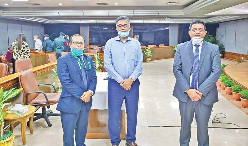 MARICO BD: PM's Principal Secretary Dr. Ahmad Kaikaus (Middle) along with Marico Bangladesh Managing Director Ashish Goupal (right) and Marico Bangladesh Chief Financial Officer Elias Ahmed, poses at the PMO on Sunday.