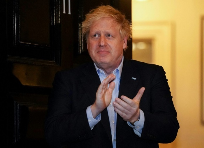 Johnson was last seen on Thursday night, joining in a weekly round of applause in appreciation of healthcare workers --10 Downing Street/AFP/File / Pippa FOWLES