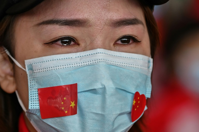 Chinese medical staff volunteers began to leave Wuhan after the airport reopened following the end to a travel ban. Photo: AFP