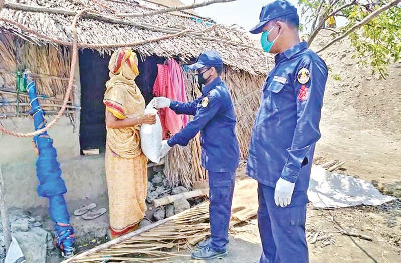 Bangladesh Coast Guard, West Zone, distributed relief materials, including food, cash money, masks and hand sanitizers among the destitute in different coastal areas including Sundarbans on Saturday to mitigate their hardship caused by the coronavirus outbreak.	photo: observer
