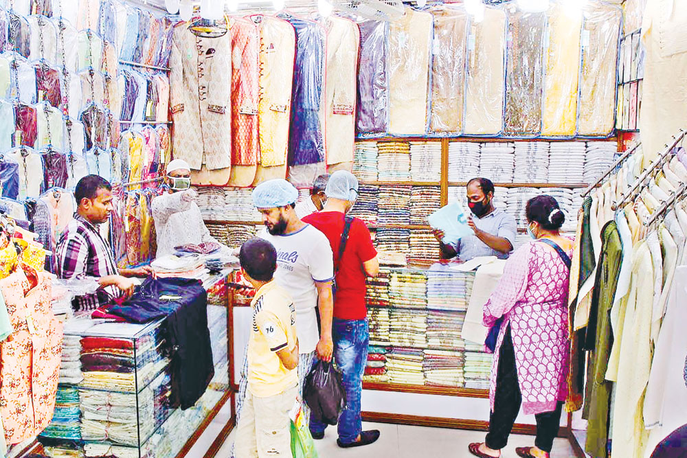 Customers flock to a shop at Eliphant Road in the capital ahead of Eid ignoring physical distancing amid the Covid-19 pandemic on Monday.	PHOTO: OBSERVER