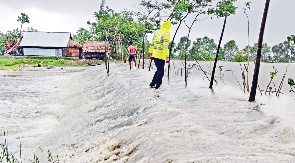 Huge tidal surges whipped up by Amphan breached embankments in many points inundating the low lying areas in Satkhira.