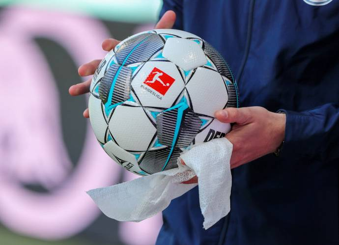 Bundesliga match balls being disinfected before the referees carried them to the pitch for the kick-off. Photo: Reuters