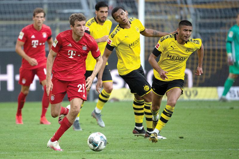 Bayern Munich's German forward Thomas Mueller runs with the ball during the German first division Bundesliga football match BVB Borussia Dortmund v FC Bayern Munich on May 26, 2020 in Dortmund, western Germany. photo: AFP