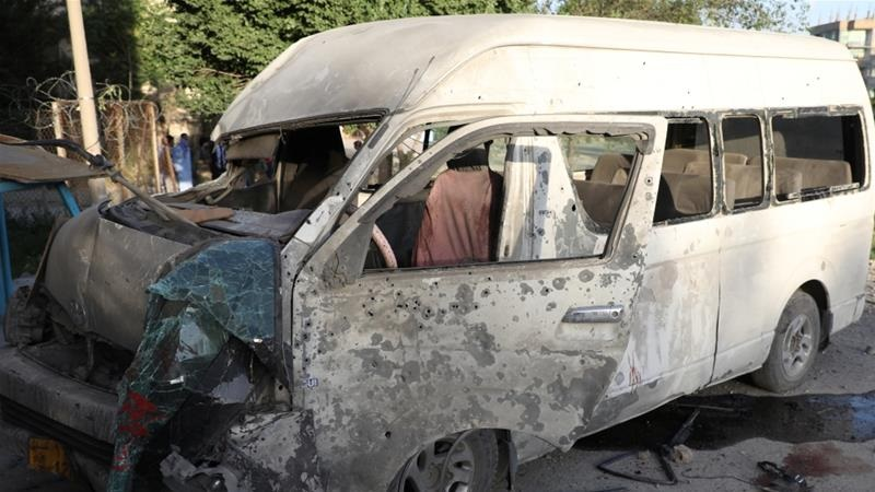 The pair died when the bus carrying 15 employees of the Khurshid TV news station was struck [Omar Sobhani/Reuters]