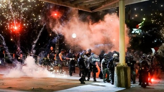 A firework explodes near a police line during a protest in Atlanta   Getty Images