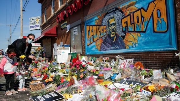 A memorial has sprung up in Minneapolis at the spot where George Floyd was arrested by police | Reuters