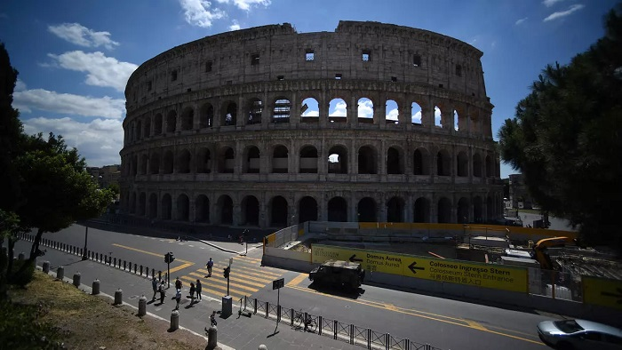 The lifting of strict measures around the world has seen the reopening of bars, cafes and tourist attractions such as the Colosseum, fuelling hopes for the economic recovery | AFP