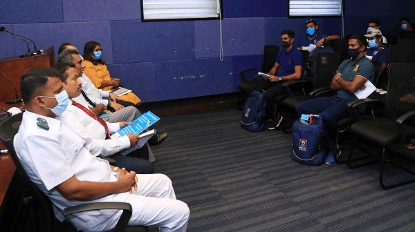 In this handout photo taken on June 1, 2020 and released by the Sri Lankan Cricket Media Division, Sri Lanka's medical officials brief national cricket team members on measures to prevent the spread of COVID-19, in Colombo. Photo: Afp