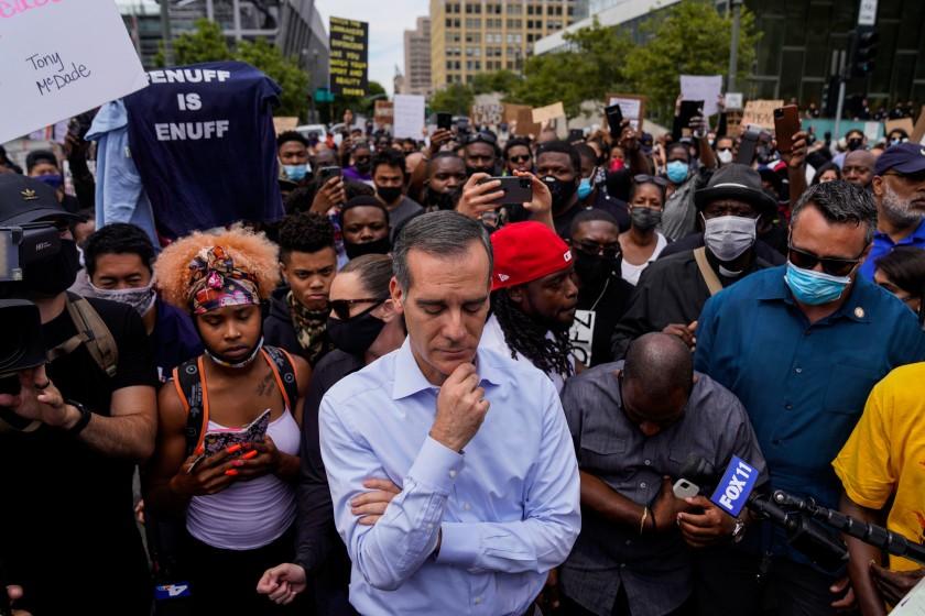 Los Angeles mayor takes knee amid peaceful protests