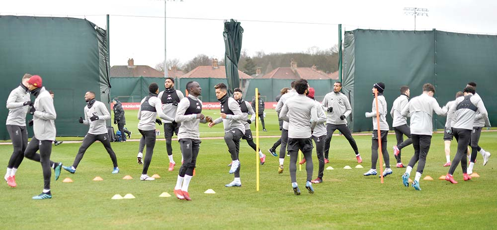 In this file photo taken on March 10, 2020 Liverpool players attend a training session at Melwood in Liverpool, north west England on the eve of their UEFA Champions League last 16 second leg football match against Atletico Madrid. - English Premier League clubs voted unanimously on May 27, 2020 to resume contact training as the English top-flight took a significant step towards a possible restart in June. The Premier League was put on hold in March due to the coronavirus pandemic, with Liverpool agonisingly close to the title. Clubs returned to training in small and socially distanced groups last week but they have now moved to stage two of the