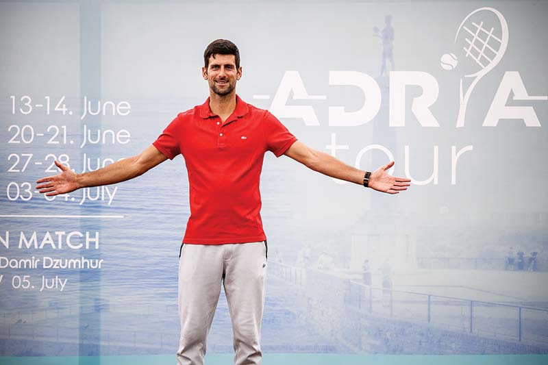 Serbian tennis player Novak Djokovic (ATP Number 1) poses for photographers after a press conference on the upcoming Adria Tour tennis tournament in Belgrade on May 25, 2020. - Djokovic will bring together international tennis stars Dominic Thiem (ATP Number 3), Alexander Zverev (ATP Number 7) and Grigor Dimitrov (ATP Number 19) to Belgrade in early June for the first in a series of humanitarian tournaments that he will organized in the Balkans.photo: AFP