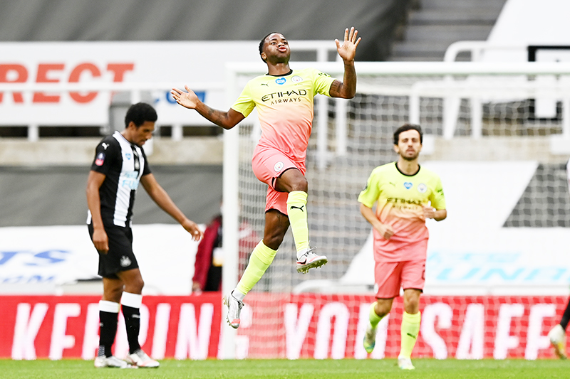Manchester City's English midfielder Raheem Sterling (C) celebrates scoring his team's second goal during the English FA Cup quarter-final football match between Newcastle United and Manchester City at St James' Park in Newcastle-upon-Tyne, north east England on June 28, 2020.photo: AFP