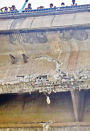 Cracks developed on the busy First Bangladesh-China Friendship (Buriganga-1) Bridge at Postogola in the capital as a salvage ship hit one of the girders of the bridge on Monday. The photo was taken on Tuesday.	PHOTO: OBSERVER