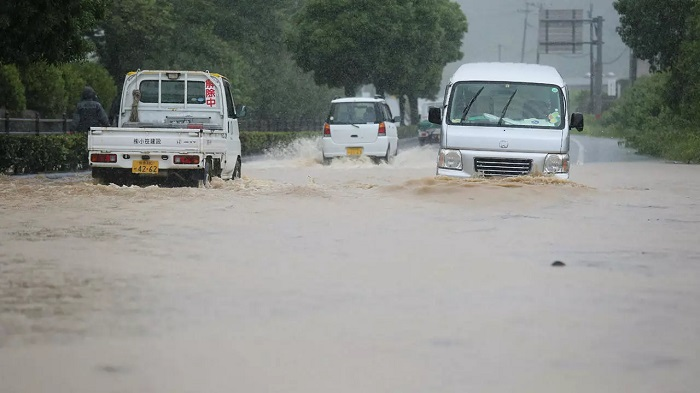 Reports said 75,000 residents were ordered to evacuate their homes, with nearly 100 people stranded JIJI PRESS/AFP