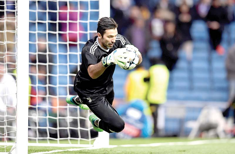 In this file photo taken on April 11, 2018 Juventus' Italian goalkeeper Gianluigi Buffon warms up before the UEFA Champions League quarter-final second leg football match against Real Madrid at the Santiago Bernabeu stadium in Madrid. photo: AFP