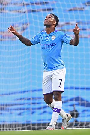 Manchester City's English midfielder Raheem Sterling celebrates after scoring their second goal during the English Premier League football match between Manchester City and Liverpool at the Etihad Stadium in Manchester, north west England, on July 2, 2020. photo: AFP